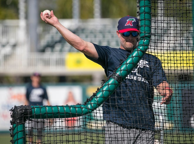 Fort Myers Miracle manager Toby Gardenhire pitches to his players during batting practice on Tuesday, April 2, 2019.