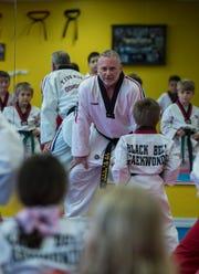 Allan Silverberg, owner of Black Belt Taekwondo in Cape Coral, conducts a kids class last month.