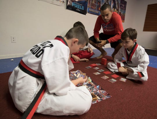 Jermaine James, an instructor at Black Belt Taekwondo in Cape Coral, interacts with some of his students.