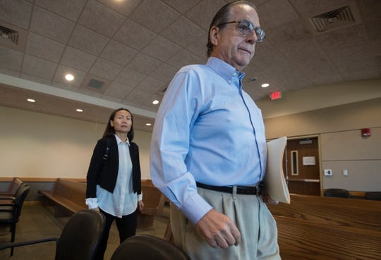 Robert Neil Jones and his wife Xuan Lang enter the courtroom of Lee county circuit judge J. Frank Porter Wednesday morning, April 3, 2019. Both plead guilty to multiple charges including racketeering and money laundering stemming from the Florida Department of Law Enforcement's Operation Spa.