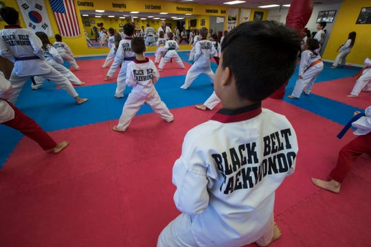 Students at Black Belt Taekwondo in Cape Coral participate in an after-school  kids class.