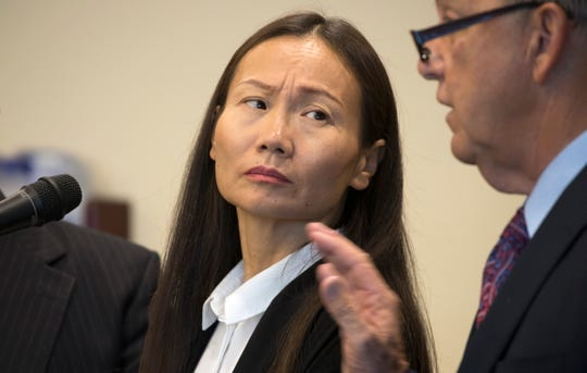 Xuan Lang listens consults with her attorney Gerald Berry during her trial in front of Lee County circuit judge J. Frank Porter Wednesday morning, April 3, 2019. Lang plead guilty to money laundering stemming from the Florida Department of Law Enforcement's Operation Spa.
