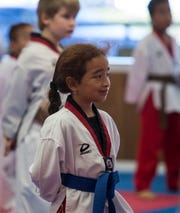 Samantha Flores, 7, of Cape Coral, participates in the kids class at Black Belt Taekwondo.