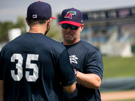 Fort Myers Miracle manager Toby Gardenhire talks to one of his players during practice on Tuesday, April 2, 2019.