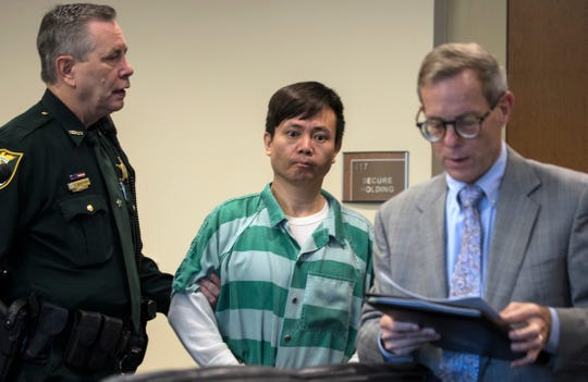 Jun Lang is led about the courtroom during his trial in front of Lee County circuit judge J. Frank Porter Wednesday morning, April 3, 2019. Lang plead guilty to multiple charges including racketeering and money laundering stemming from the Florida Department of Law Enforcement's Operation Spa.