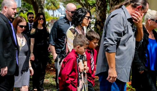 Layla's mother, Kathleen Aiken walks into the funeral home with her twin boys. A memorial service was held Wednesday afternoon for 8-year-old Layla Aiken, who was hit by a pickup truck while waiting at her bus stop with her twin brothers. Layla's family and friends walked into Gallaher Funeral Home in Fort Myers giving hugs with tears in their eyes.