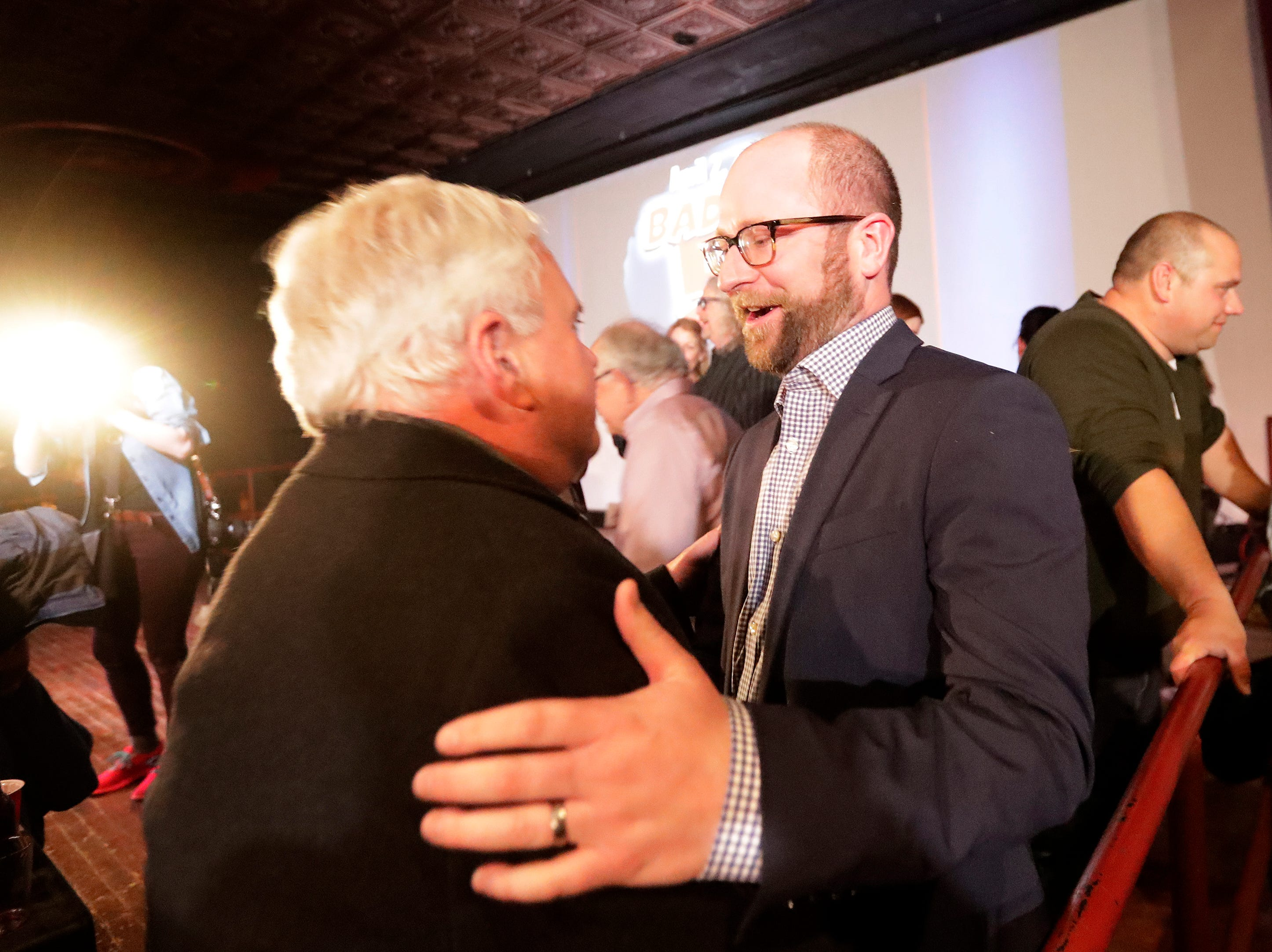 Mayor-elect Eric Genrich greets supporters on election night in at the Tarlton Theater on Tuesday, April 2, 2019 in Green Bay, Wis.