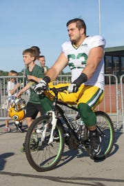 Travis Kohlbeck and Green Bay Packers center Corey Linsley first met in 2014 when Linsley started riding the boy's bike at training camp. That longstanding Packers tradition was the start of a close friendship between the Linsley and Kohlbeck families that includes Thanksgiving dinners, birthday parties and tailgating.