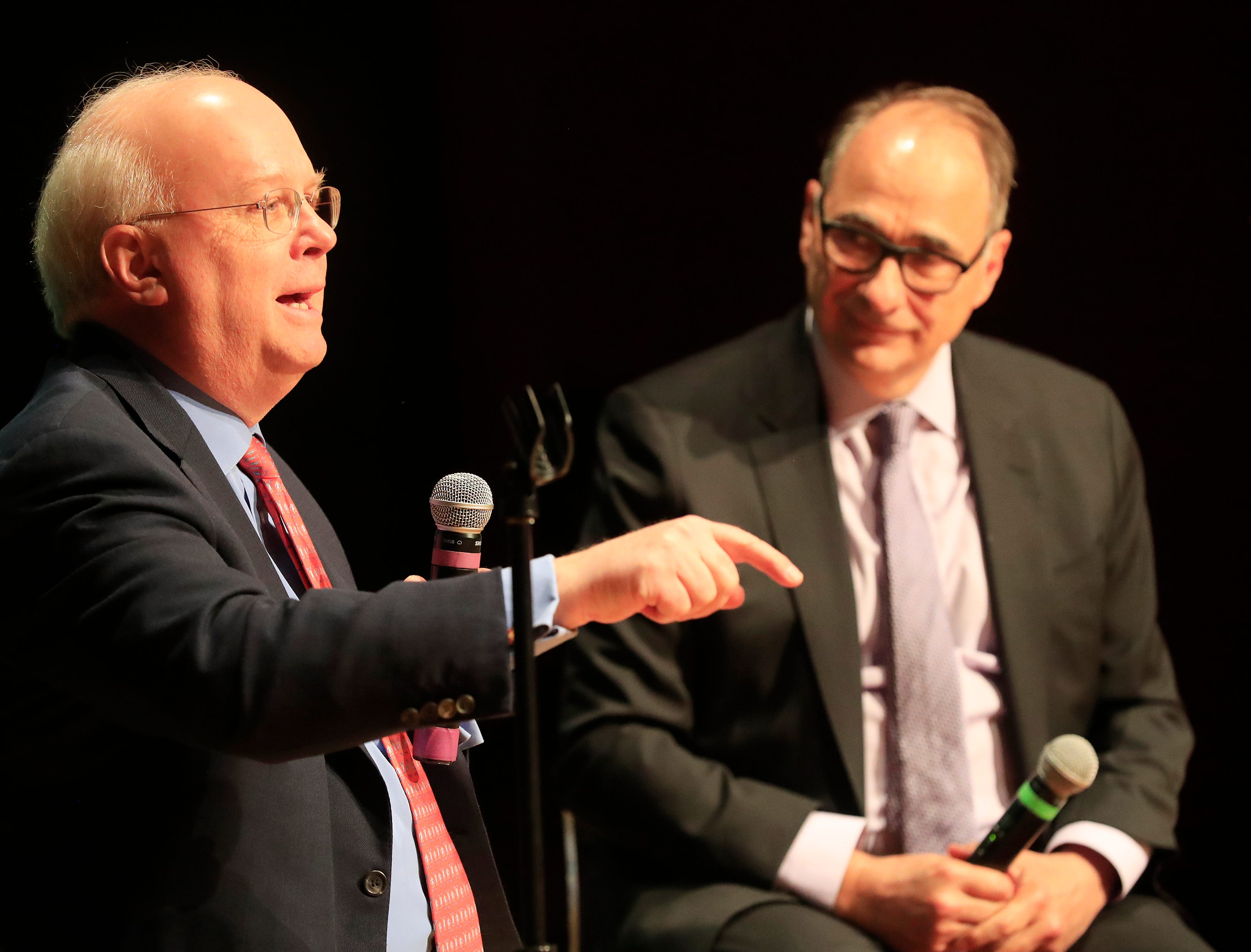 Political consultants Karl Rove (left) and David Axelrod speak to members of the media before their point-counterpoint event at UW-Green Bay on Wednesday, April 3, 2019 in Green Bay, Wis.
