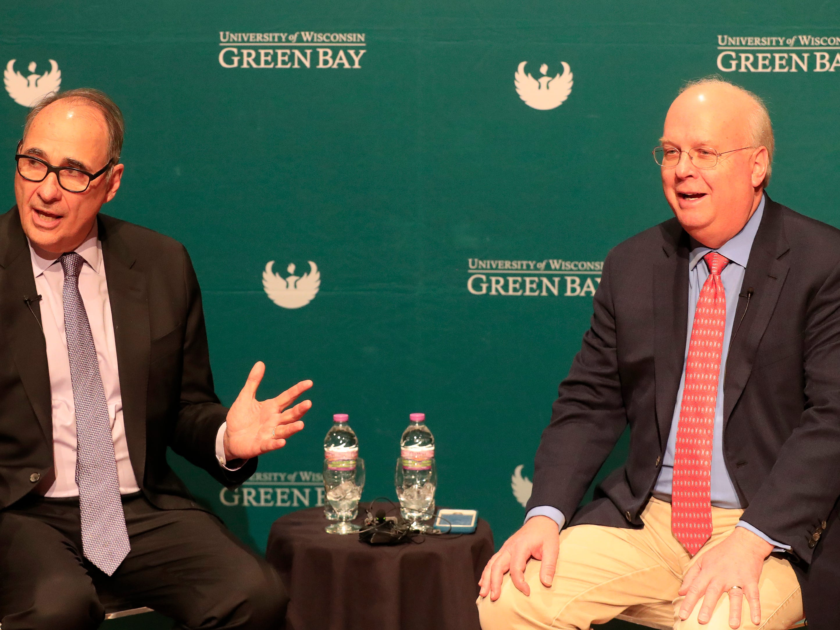 Political consultants David Axelrod (left) and Karl Rove speak to members of the media before their point-counterpoint event at UW-Green Bay on Wednesday, April 3, 2019 in Green Bay, Wis.