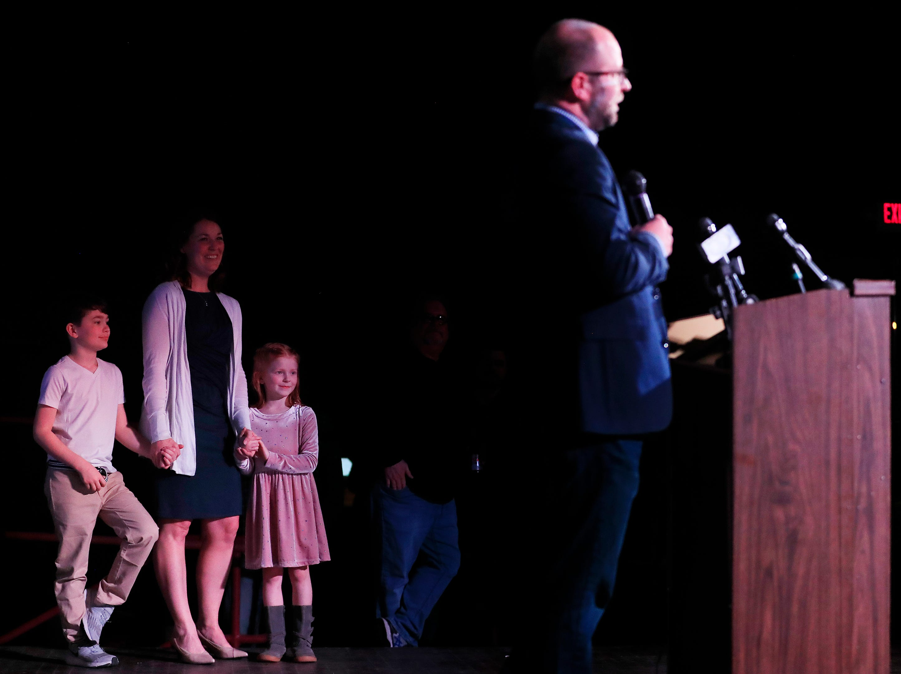 Mayor-elect Eric Genrich's wife Emily, and children Henry and Amelia watch as he gives his victory speech at the Tarlton Theater on Tuesday, April 2, 2019 in Green Bay, Wis.