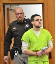 Timothy Grimes enters Oconto County Circuit Court on Tuesday, escorted by court security officer Ron Ripley, for sentencing on two counts of sexual assault of a student by school staff over incidents with a 17-year-old girl in the spring of 2018.