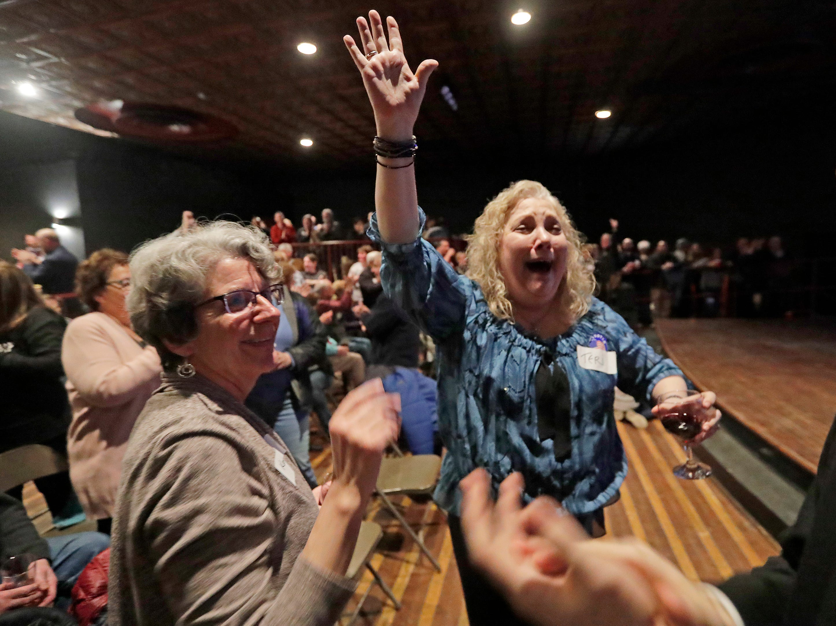 Teri Kilp, supporter of mayor-elect Eric Genrich reacts as the election results are announced at the Tarlton Theater on Tuesday, April 2, 2019 in Green Bay, Wis.
