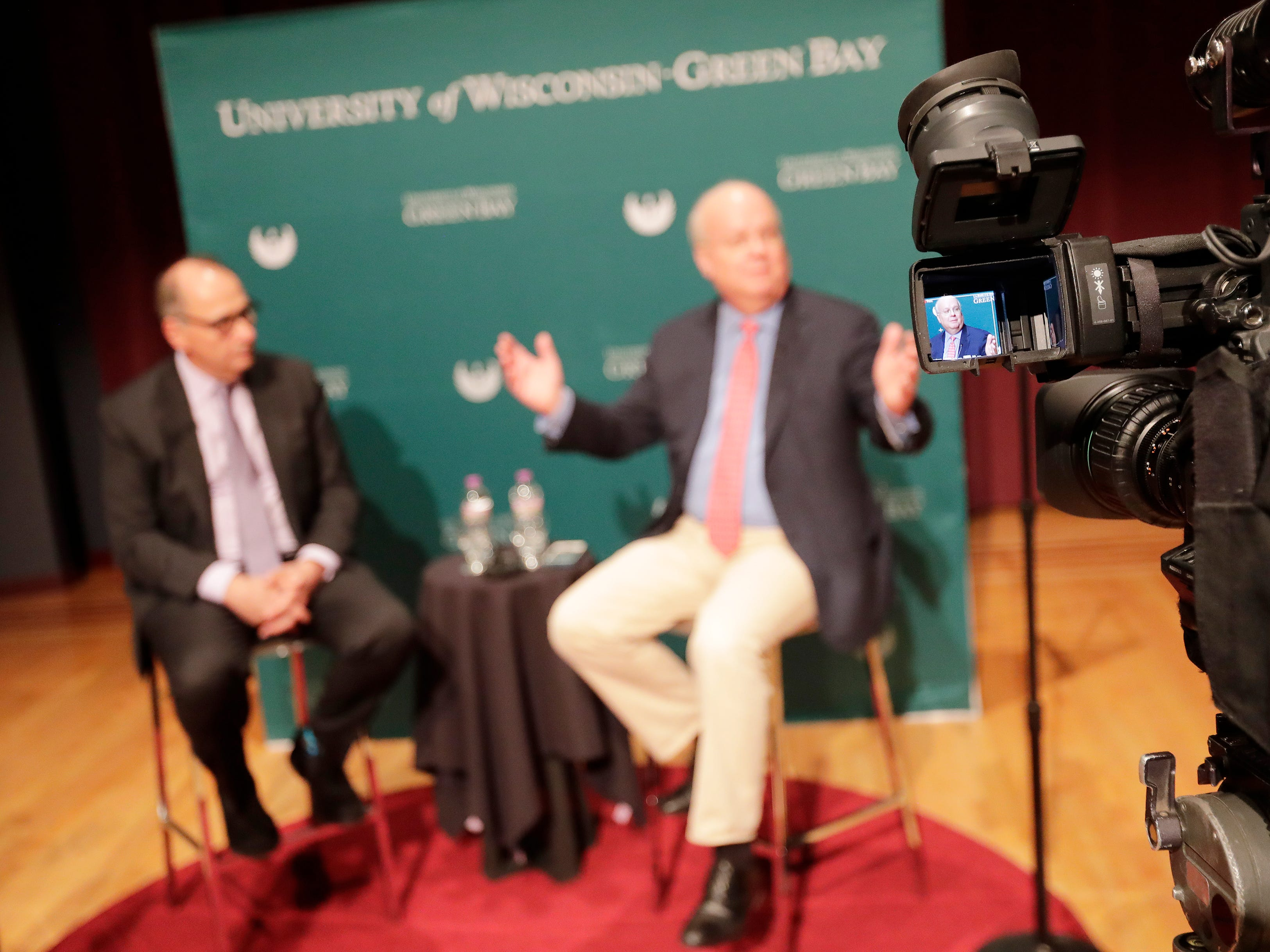 Political consultants Karl Rove and David Axelrod speak to members of the media before their point-counterpoint event at UW-Green Bay on Wednesday, April 3, 2019 in Green Bay, Wis.