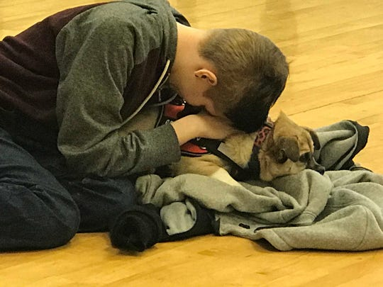 """Eliana Stahl and service dog Abbey in a scene from this year's """"LEAP: The Human Kindness Project"""" production. The theme for this year's program, created and performed by Door County high school students, is loneliness and inclusion."""