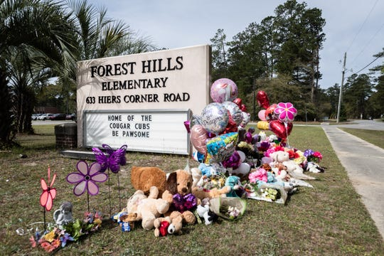 A memorial at the sign of Forest Hills Elementary School in Walterboro, South Carolina, where Raniya Wright, the fifth grade student who died March 27, 2019, after a fight at school two days earlier. On Friday, April 19, 2019, officials said Raniya's death was related to a congenital condition called arteriovenous malformation, or AVM.
