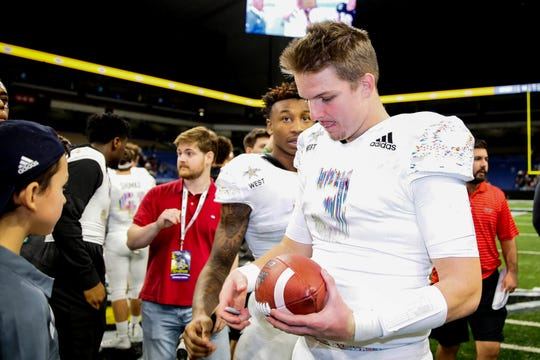 USC freshman quarterback Ryan Hilinski (3) signs autographs after the U.S. Army All-American Bowl high school football game at the Alamodome last year.