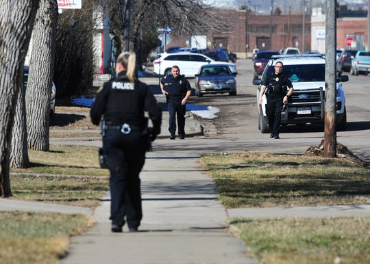 Great Falls Police officers respond to an alarm call on the south side of Great Falls Tuesday.