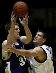 Carroll College star Jeff Hays, left, works against Texas Wesleyan's Andrew Bradford during the 2006 NAIA National Tournament in Kansas City. Hays is now the head boys' basketball coach at Missoula Hellgate, following in his father's footsteps.