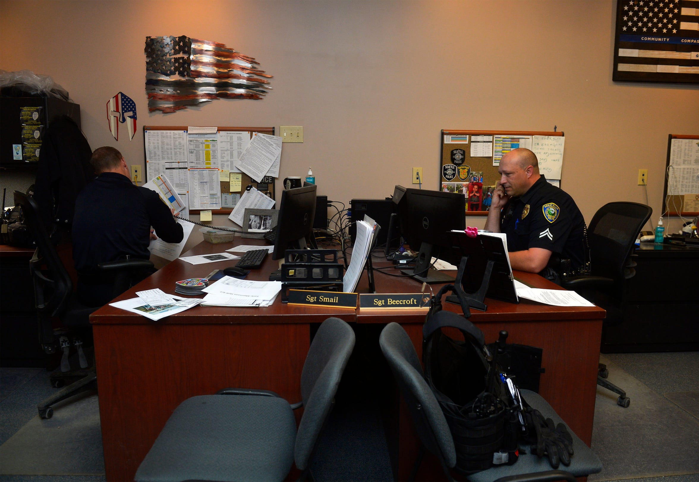 Supervisors at the Great Falls Police Department communicate in the shift commander's office. According to GFPD Detective Katie Cunningham, the rise of social media may come at the expense of deeper relationships between officers.