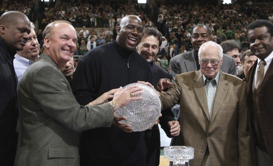 Members of Michigan State's 1979 NCAA championship basketball team, including front row from left, Jay Vincent, Terry Donnelly, Earvin (Magic) Johnson, coach Jud Heathcote and Gerald Gilkie, hold the championship trophy during a ceremony commemorating the 30th anniversary of the event on Feb. 22, 2009. Eric Hays of Missoula, a former Montana Grizzly superstar hoop player, had been one of Heathcote's assistant coaches two years before and had a hand in recruiting Johnson and Vincent.