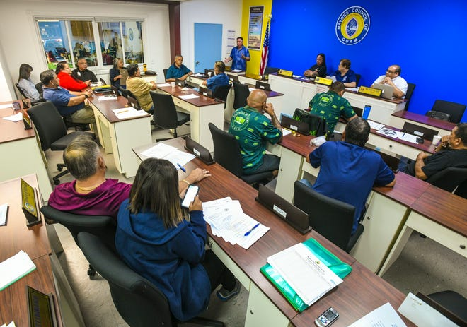 Angel Sablan, standing, Mayors' Council of Guam executive director, updates village leaders on the status of rules involving games of chance being held at the upcoming Liberation Day carnival, during a council meeting in Hagåtña on Wednesday, April 3, 2019.