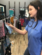 Brooke Warren of Petal checks out the selection of boot socks sold at Tack of the Town in Ridgeland.
