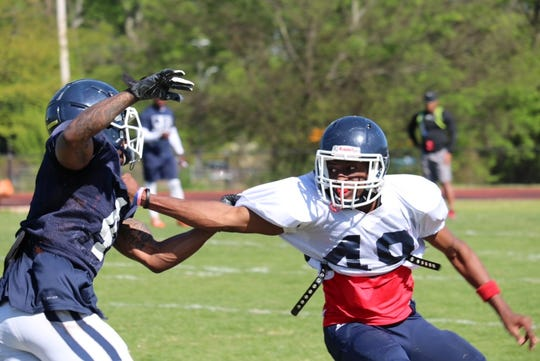 Jackson State wide receiver Terrell Kennedy III (4) tries to make a move past defender Mark Rudison (49) during Tuesday's practice.