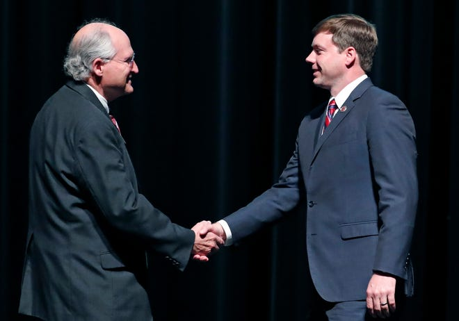Former Supreme Court Chief Justice Bill Waller, left, and Rep. Robert Foster, R-Hernando, shake hands prior to a Republican gubernatorial debate for governor of Mississippi in Starkville, Miss., Tuesday, April 2, 2019. Republican Lt. Gov. Tate Reeves did not take part in the debate.