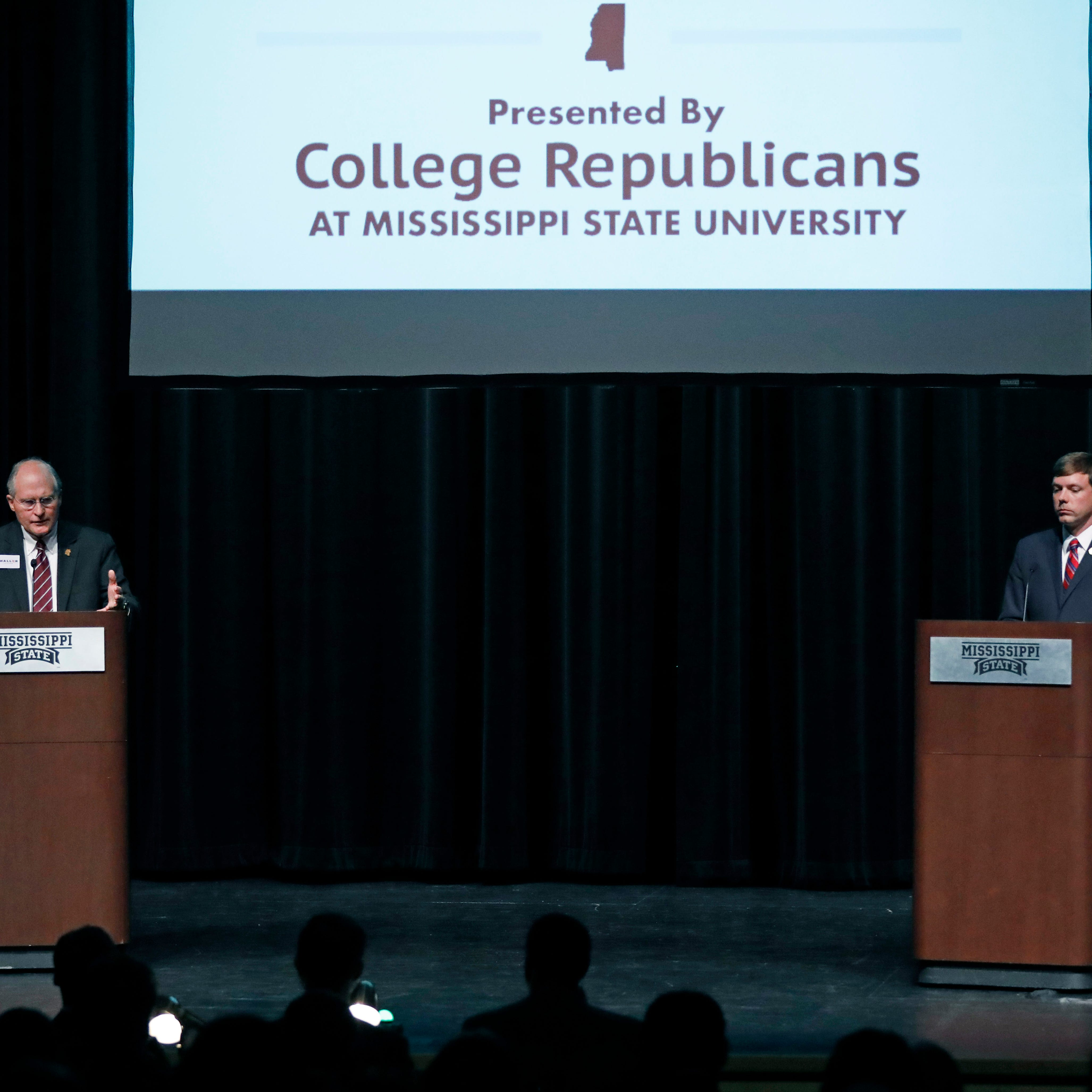 Former Supreme Court Chief Justice Bill Waller, left, gestures during a debate between himself and Rep. Robert Foster, R-Hernando, during a Mississippi Republican gubernatorial debate in Starkville, Miss., Tuesday, April 2, 2019. Republican Lt. Gov. Tate Reeves, also a candidate, did not take part in the debate.