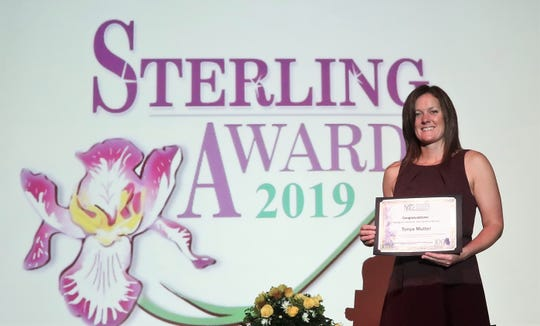 Tonya Mutter, a student at Jackson State, was awarded the Margaret Faulkner Scholarship at the Sterling Awards. She has raised five children while working three jobs after losing her husband in a car wreck 11 years ago.