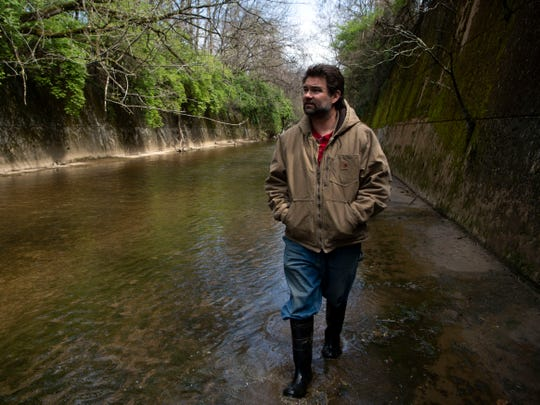 City councilman Mark Campen walks along the edge of First Creek on Tuesday, April 2, 2019. Campen is supportive of a possible ballpark in the Old City and said he hopes project leaders will take First Creek's possibilities into their plans.
