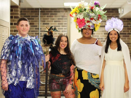 Student Hope Benn's mother, Anita, made the headdresses, and the island wear was inspired by the original Broadway musical and includes thrift store island wear finds. Behind the scenes, from left: Brett Beard, Katie Thorpe, Hope Benn, Mikayla Maldonado. March 28, 2019.