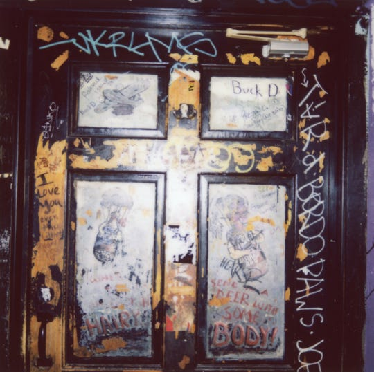 Graffiti adds a certain charm to the door of one of the downstairs Preservation Pub bathrooms.
