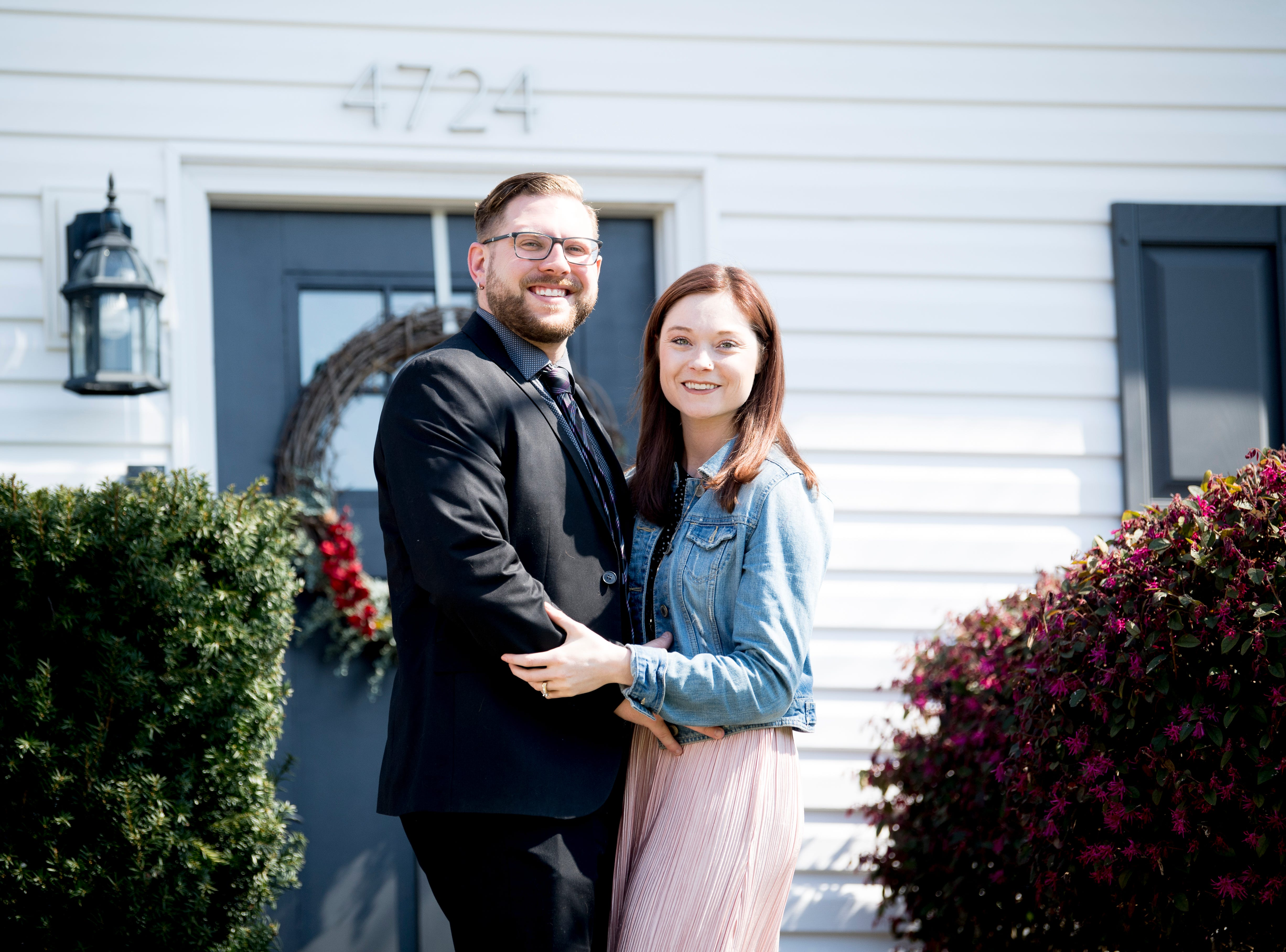 Austin Miller, 30, and his fiancé Trissa Gurney, 27, pose outside of their home off McKamey Road west of Knoxville, Tennessee on Wednesday, April 3, 2019. After months of house searching, the couple decided to move into their current home last December after making some small compromises like being further away from downtown.