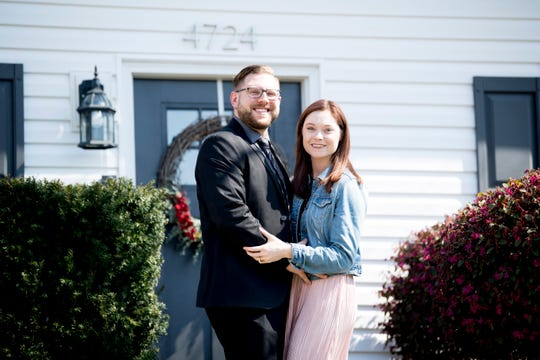 Austin Miller, 30, and his fiancé Trissa Gurney, 27, pose outside of their home off McKamey Road west of Knoxville on April 3. After months of searching, the couple decided to move into their current home last December after making some small compromises like being further away from downtown.