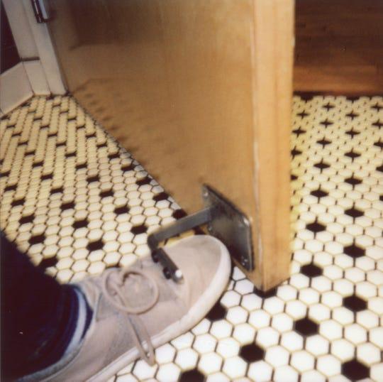 "A ""toepener"" is utilized by News Sentinel digital producer Kelli Krebs in the Tomato Head women's bathroom."