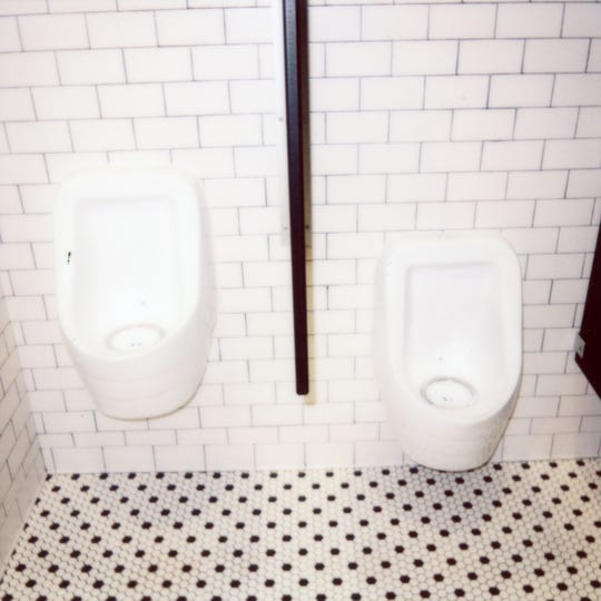The eco-friendly, with water-free urinals inside the men's bathroom at Tomato Head.