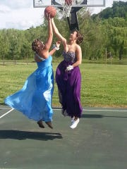 Before Powell's prom her senior year, Shea Coker, left, and teammate Jill Gorman couldn't resist some hoops.