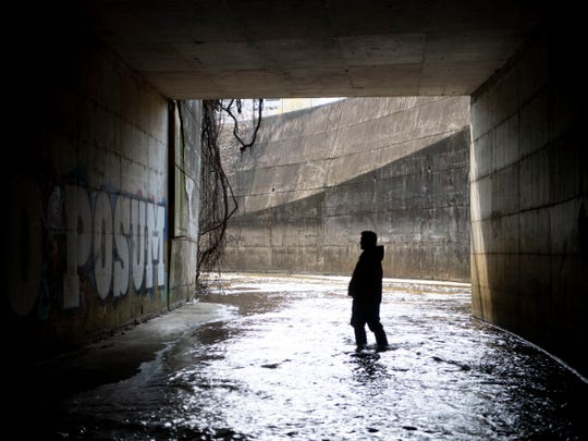 Mark Campen explores First Creek tunnel that runs under James White Parkway and Hall of Fame Dr. The tunnel exits near the Downtown dog park.