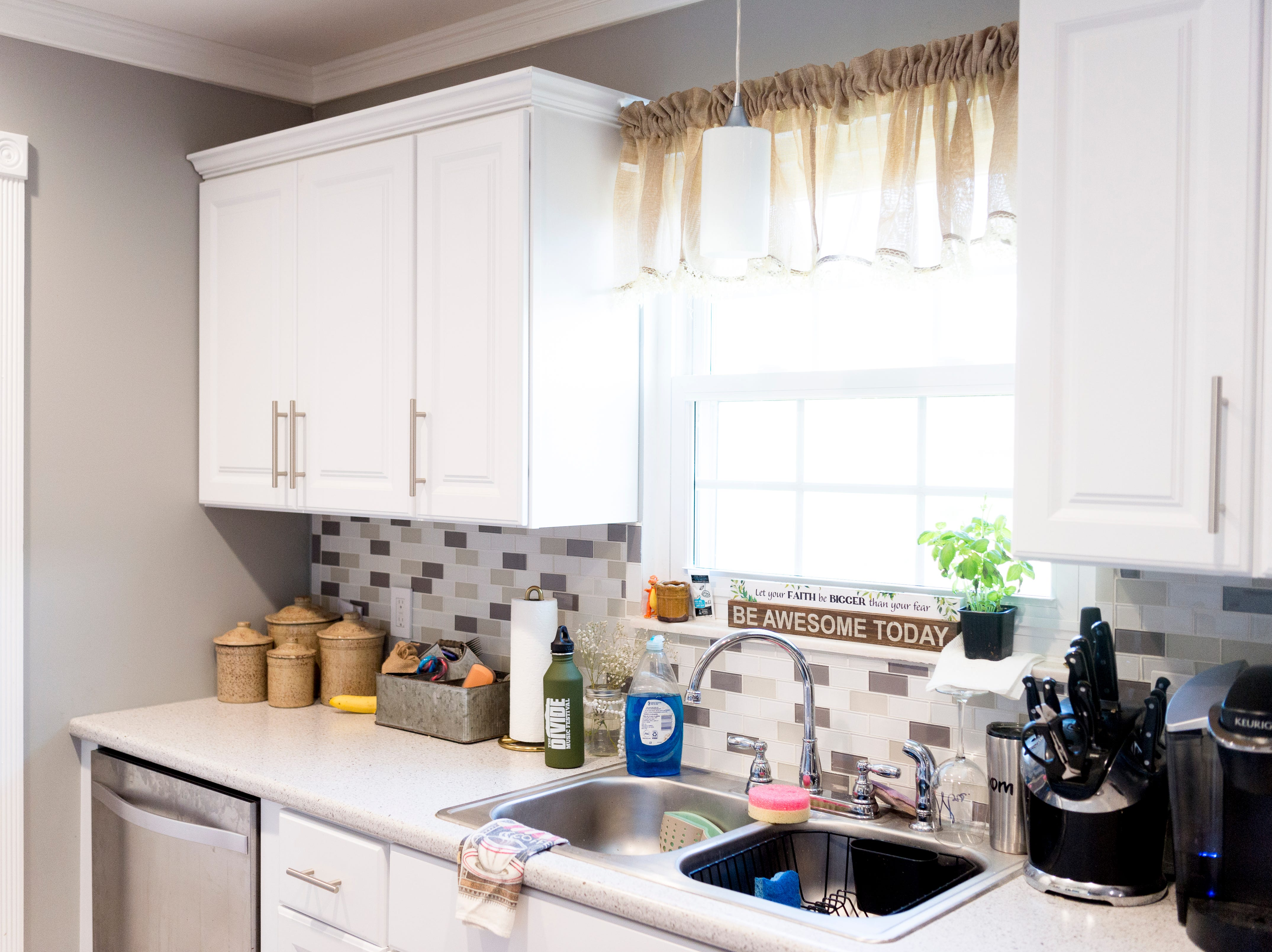 The kitchen of Miller and Gurney's home off McKamey Road west of Knoxville, Tennessee on Wednesday, April 3, 2019. After months of house searching, the couple decided to move into their current home last December after making some small compromises like being further away from downtown.