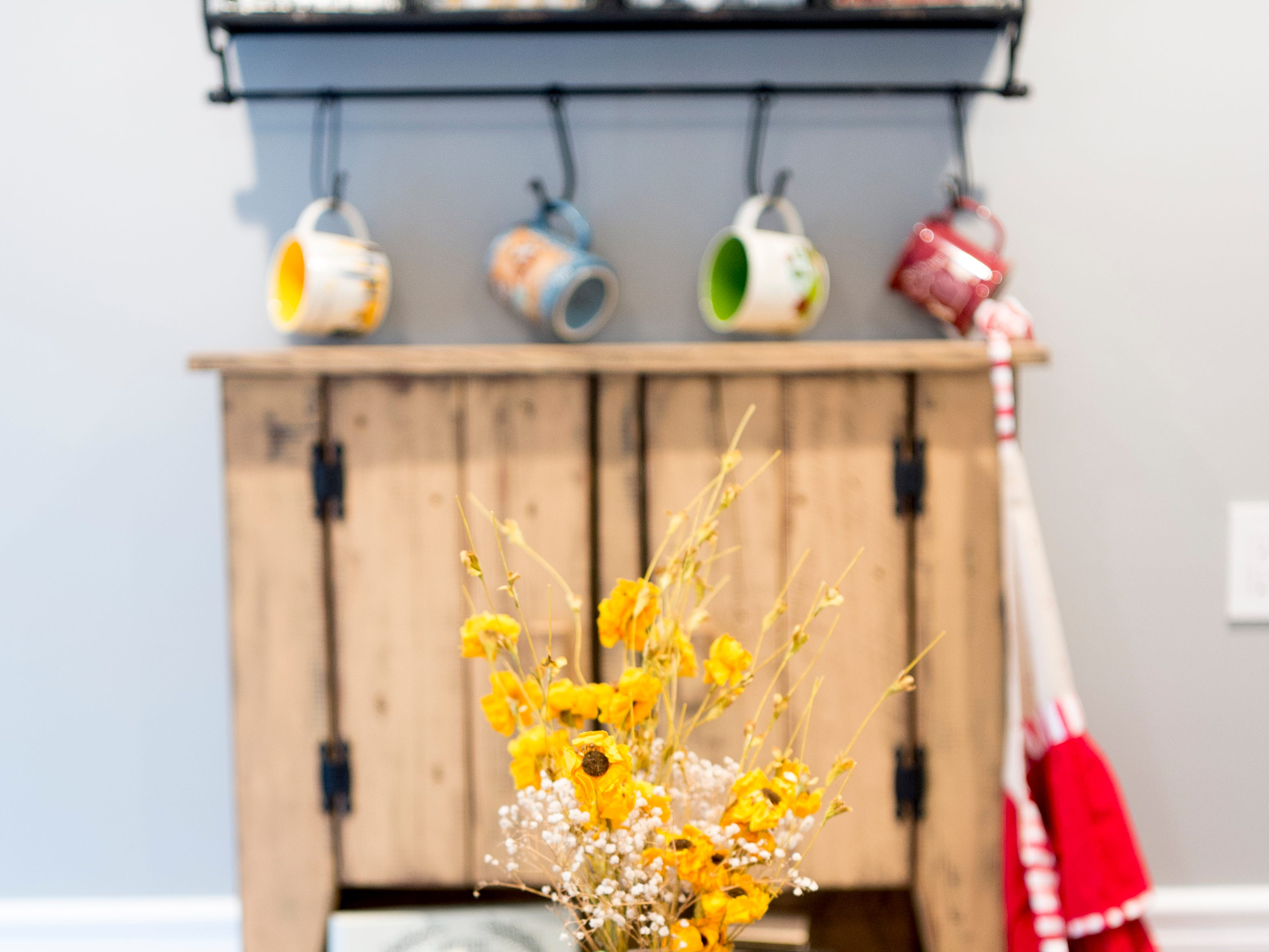 Decorations adorn the dining area in their home off McKamey Road west of Knoxville, Tennessee on Wednesday, April 3, 2019. After months of house searching, the couple decided to move into their current home last December after making some small compromises like being further away from downtown.