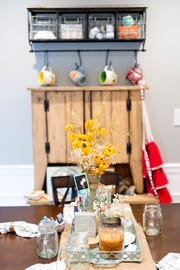 "Decorations adorn the dining area in Austin Miller and Trissa Gurney's home off McKamey Road. ""For the most part, we're just really pleased with the house that we got,"" Gurney said."