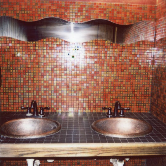 The sinks in the upstairs women's bathroom of Preservation Pub.