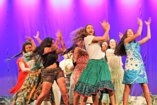 """""""Once on This Island"""" at Central High School is """"the most fun show I have seen in a long time,"""" said Sarah Toll, Central's theater teacher. Pictured March 28, foreground, are Tianna Williams, Katie Thorpe, Kenna Lyle, and Lexie Dishner."""