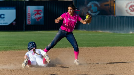 Rebels Vyctorhea Romero covers second as Teurlings Catholic host St Thomas More Softball. Tuesday, April 2, 2019.