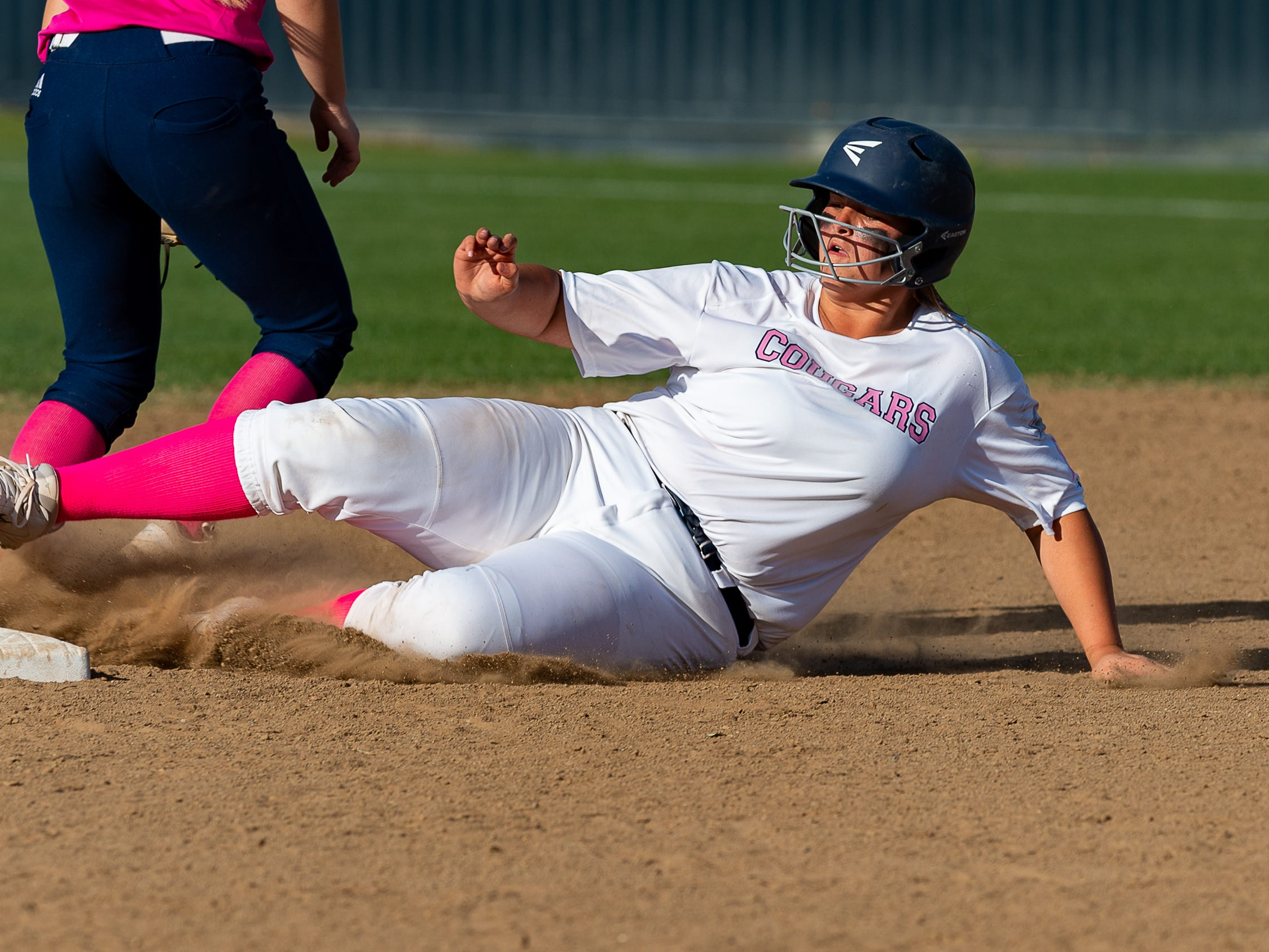 Hannah Parker slides into second as Teurlings Catholic host St Thomas More Softball. Tuesday, April 2, 2019.