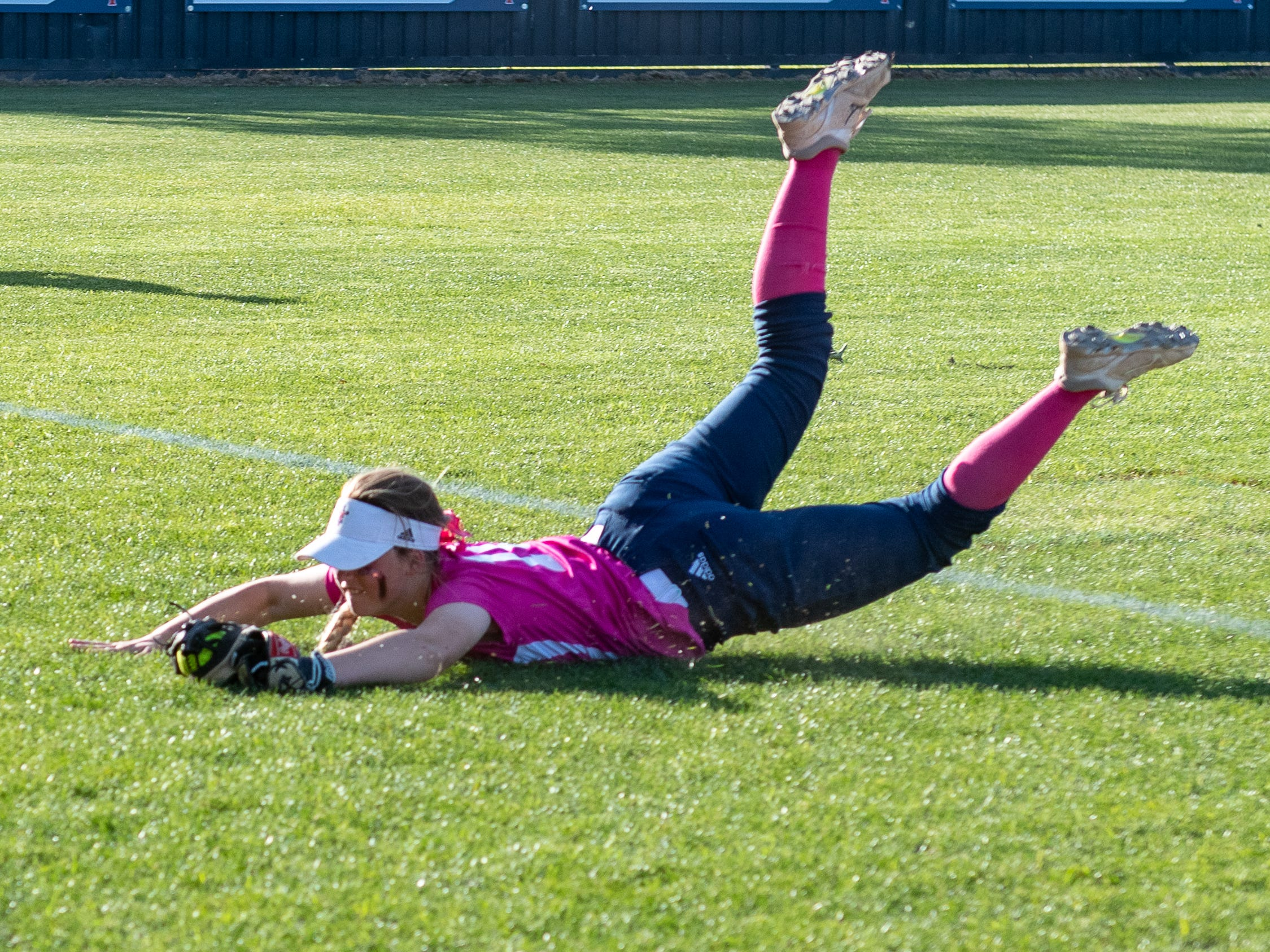 Krystyn Lormand dives to make a catch as Teurlings Catholic host St Thomas More Softball. Tuesday, April 2, 2019.