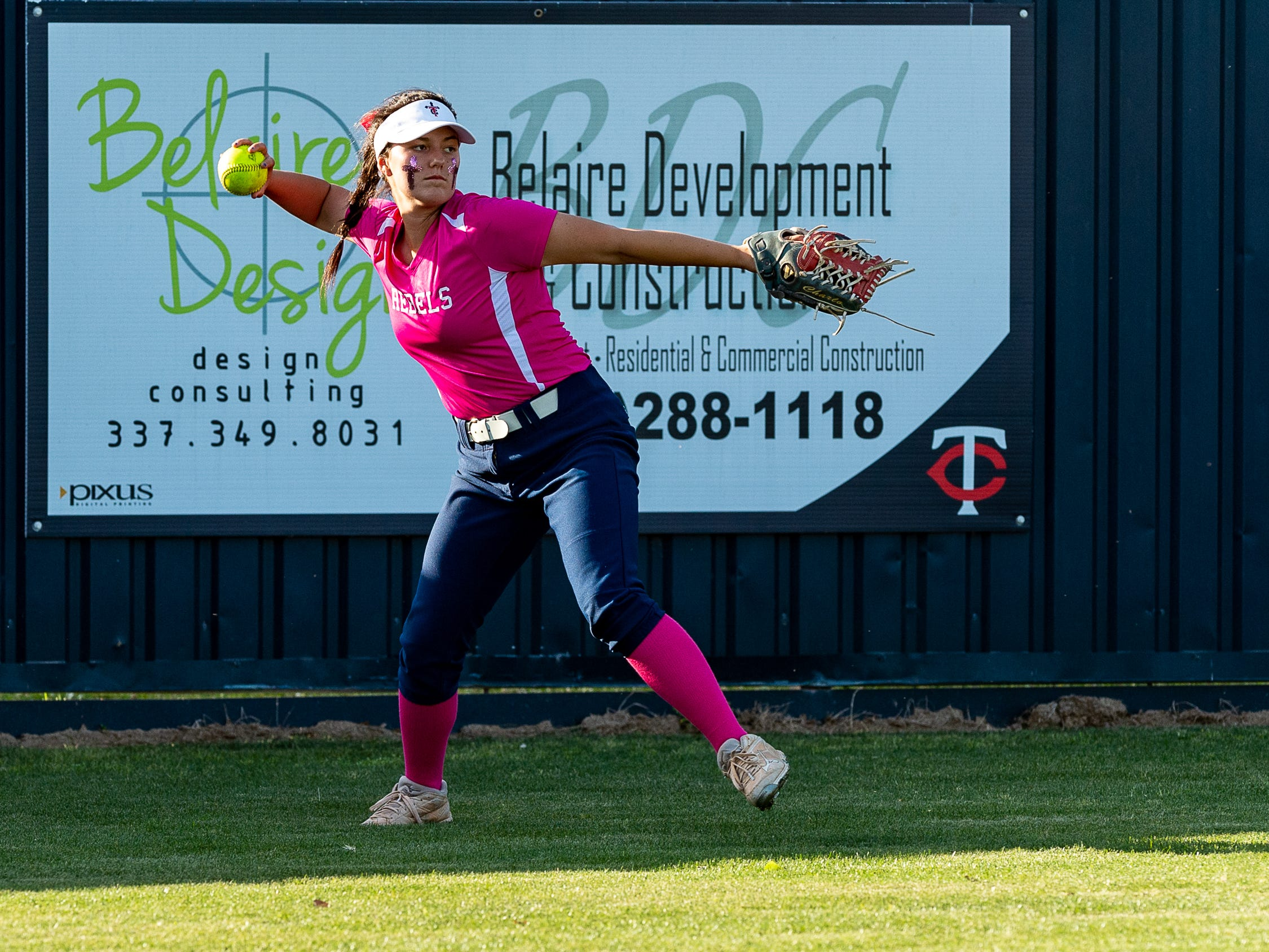 Charli Broussard in centerfield as Teurlings Catholic host St Thomas More Softball. Tuesday, April 2, 2019.