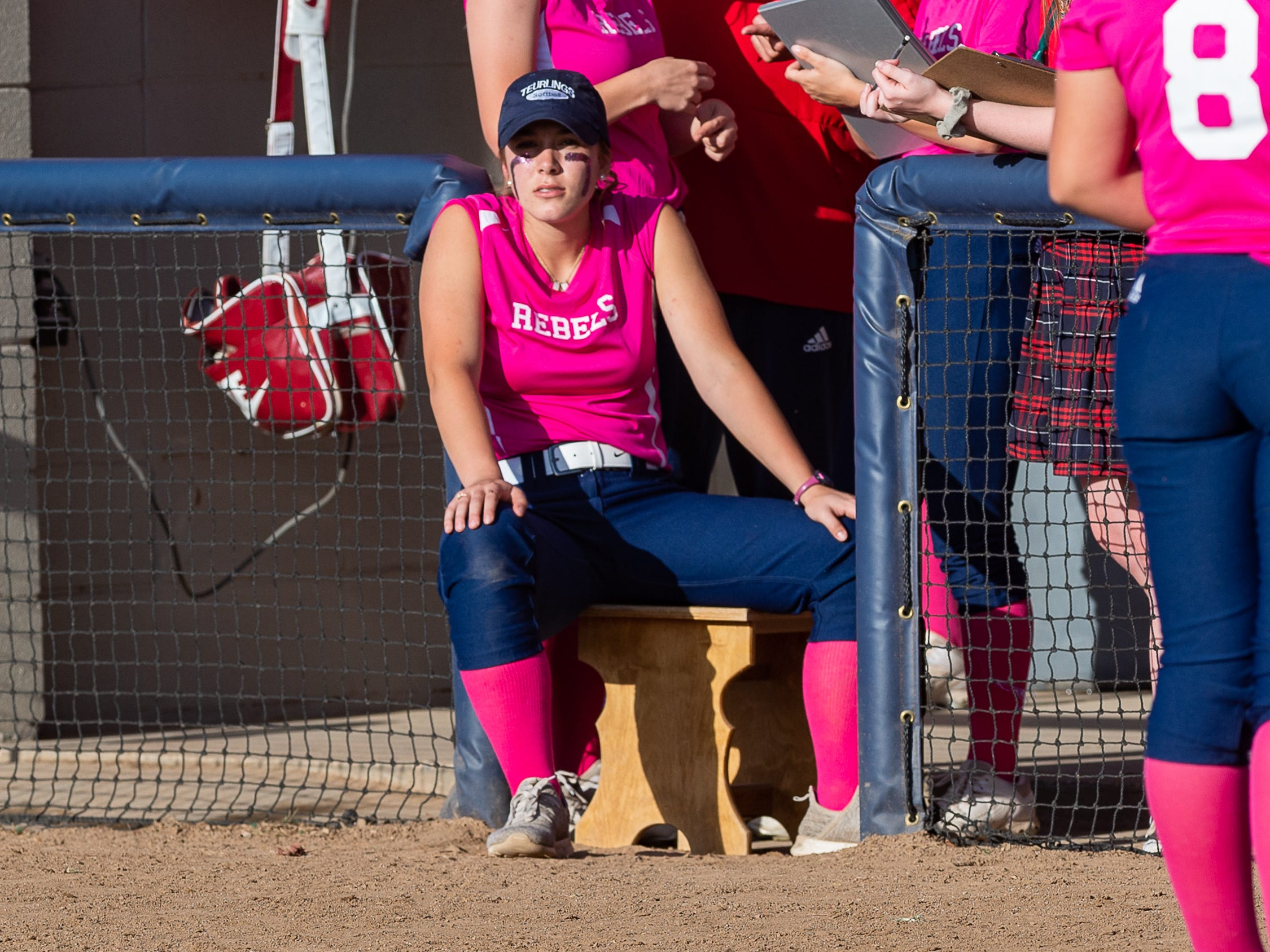 Emily Hebert in the dugout as Teurlings Catholic host St Thomas More Softball. Tuesday, April 2, 2019.
